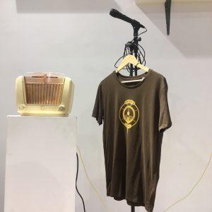 Ochre ink logo on Bakelite Brown T-shirt
